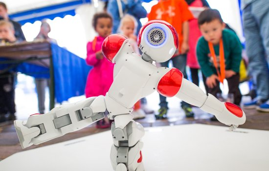 Visitors at Bradford Science Festival watching NAO robot, photographed by Jody Hartley
