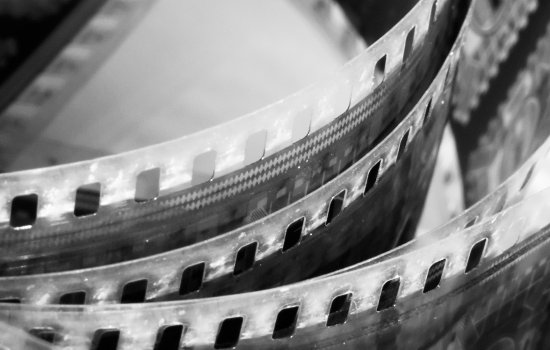 An image of film strips on a reel