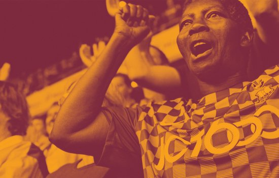 Image shows a female Bradford City fan cheering while watching a match