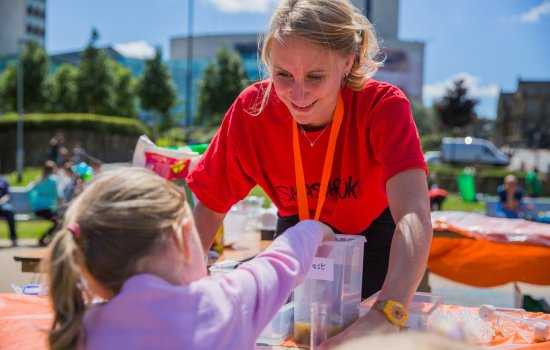 A girl takes part in family activities at Bradford Science Festival