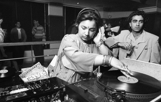 Ranjit Kaur, aka Radical Sista, DJing at a daytimer in Bradford in the late 1980s