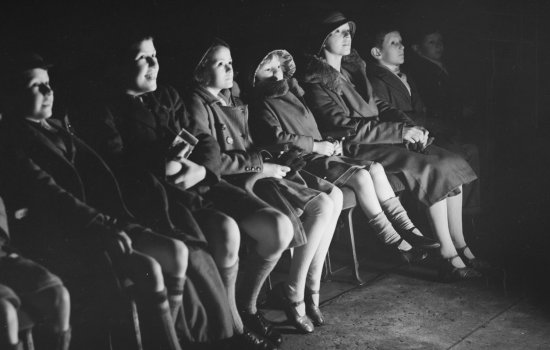Audience members watching a film