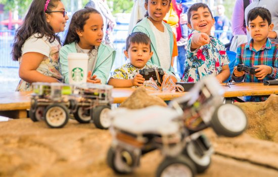A group of children watch a Mars rover at a Bradford Science Festival event