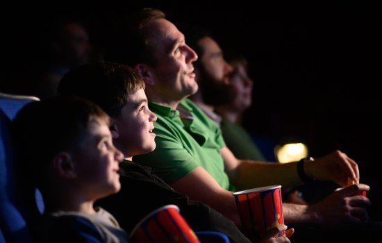 Family watching a film in Pictureville Cinema