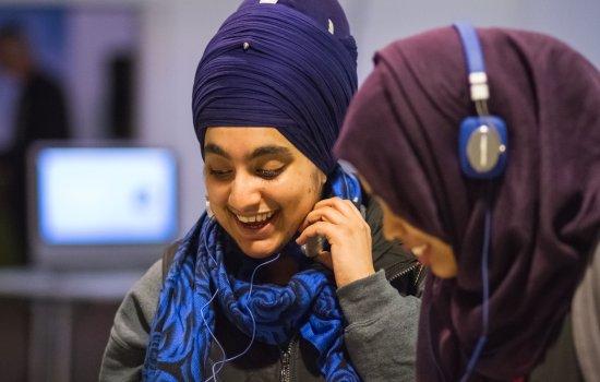 Visitors with headphones