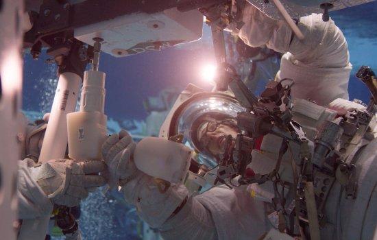An astronaut in his spacesuit training underwater