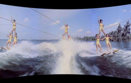 Widescreen view of women waterskiiing