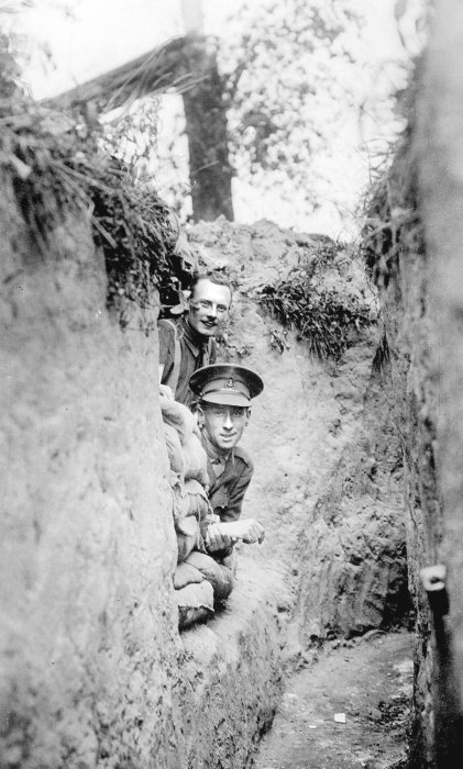 Captain Harry Colver (below) and Captain George Hewitt, 1/5 York and Lancaster Regiment, peep out of their dugout near the Yser Canal north of Ypres, 1915. © Jon Cooksey