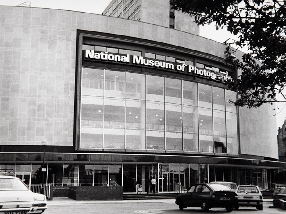 A black and white photograph of the exterior of the museum in 1983
