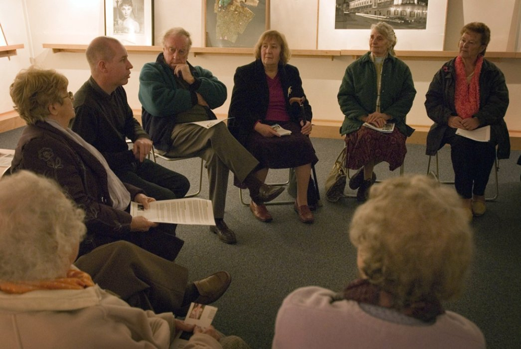 A volunteer leading a group discussion at one of our Reminiscence Sessions
