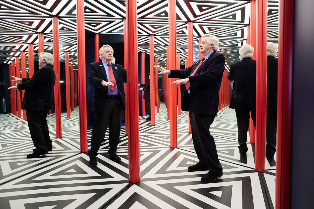 Lord Grade tests out the mirror maze in Wonderlab at the National Science and Media Museum, Bradford