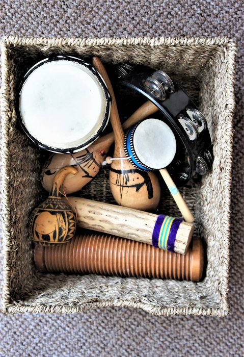 Image of percussion instruments in a wicker basket