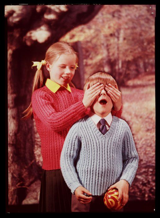 Girl with hands over boy's eyes, about 1950, Photographic Advertising Agency
