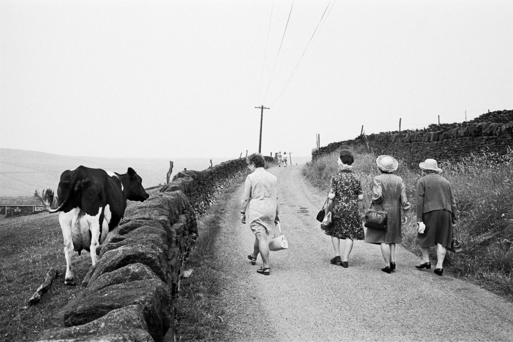 Congregation making their way to the Crimsworth Dean Methodist Chapel anniversary service, 1975, Martin Parr © Martin Parr / Magnum Photos