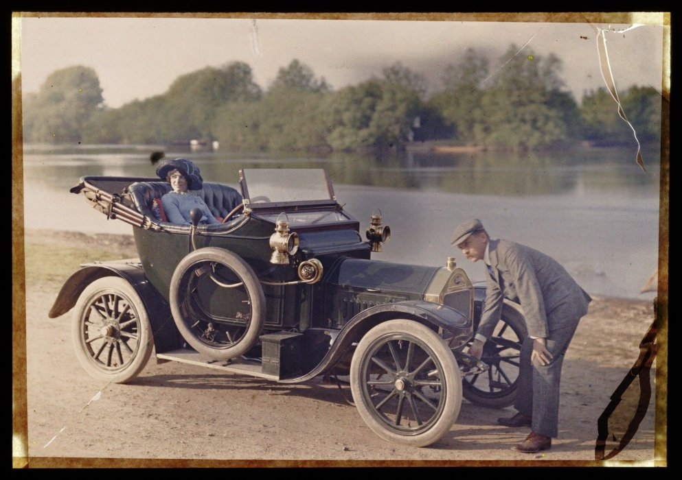 Couple with a motor car, c.1910