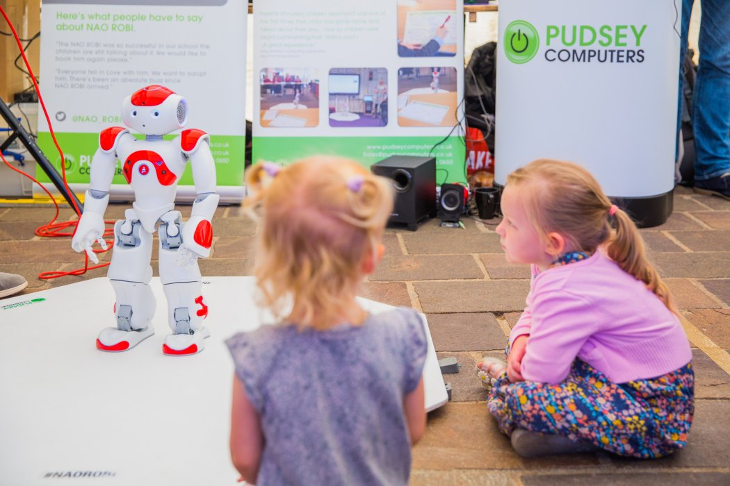 Visitors at Bradford Science Festival with NAO robot, photographed by Jody Hartley