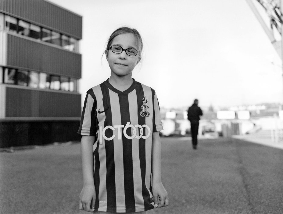 Image shows a young girl wearing a Bradford City shirt