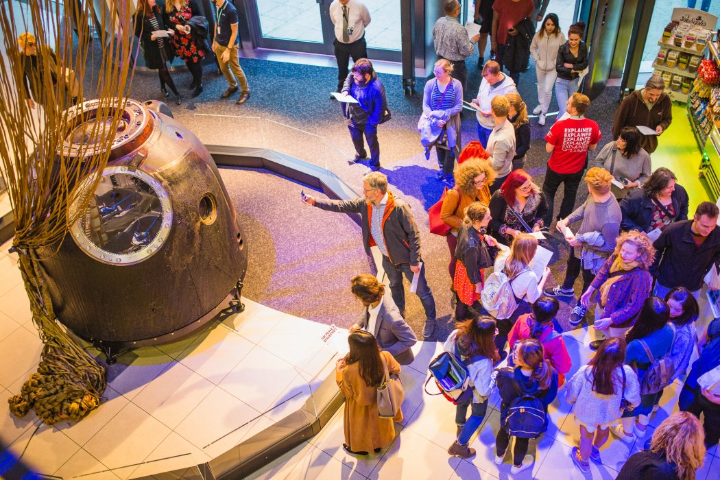 Visitors to Lates: Space inspect the Soyuz capsule