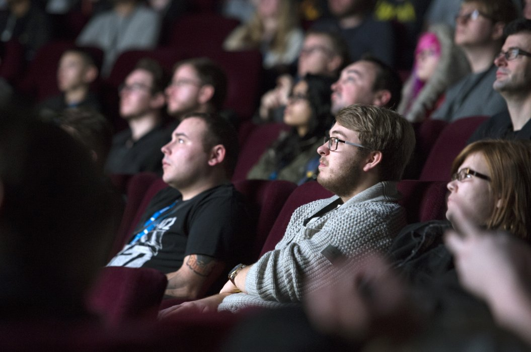 Image shows audience members looking at the screen during a Pictureville Cinema event