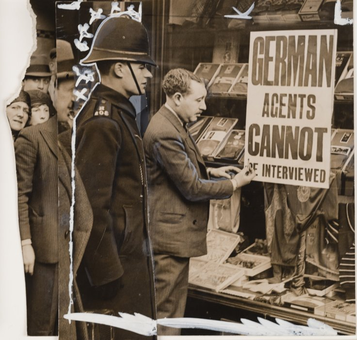 Image of policeman watching over a protester, with markup on the image showing the figure of the policeman has been moved