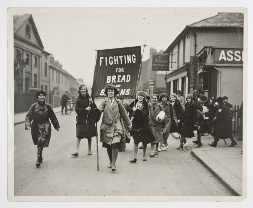 Black and white photograph of a group of women taking part in a protest march