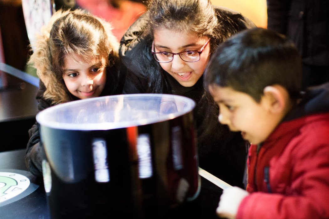 Children looking at an optical toy in the Animation Gallery