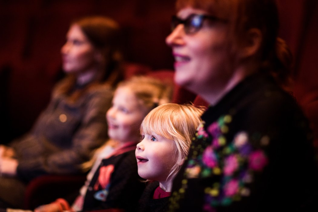Family visitors watching a film in Pictureville Cinema