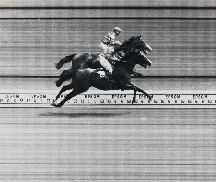 Black and white photograph of a photo-finish in a horse race