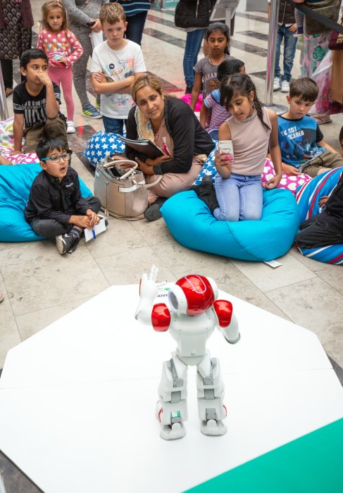 Families watching Nao the robot at a Bradford Science Festival event
