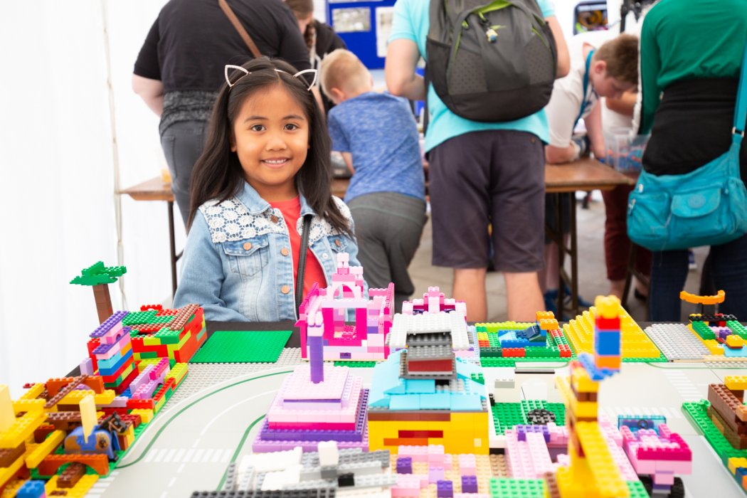 A young visitor with the 'Future Bradford' model at Bradford Science Festival