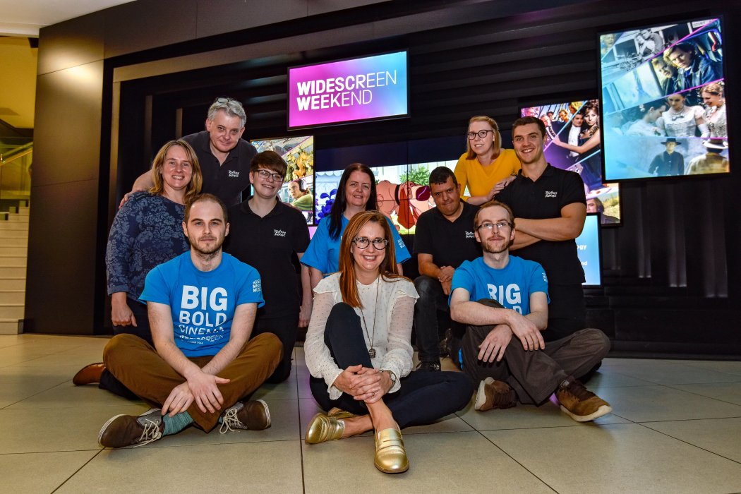 The Widescreen Weekend festival team in the museum foyer