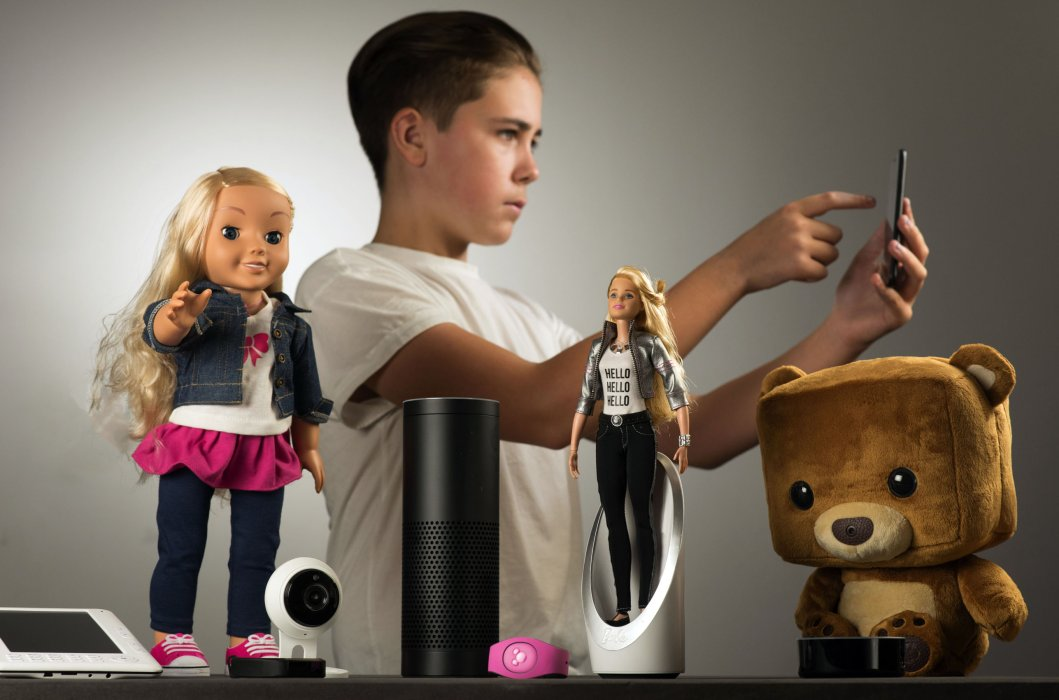 Model with internet connected devices: e-reader, My Friend Cayla doll, Fitbit activity tracker, security webcam, Echo smart speaker, Disney World MagicBand, Hello Barbie doll, Echo Dot smart speaker, Fisher Price Smart Bear