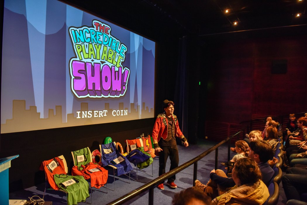 The presenter of The Incredible Playable Show on stage in Cubby Broccoli Cinema