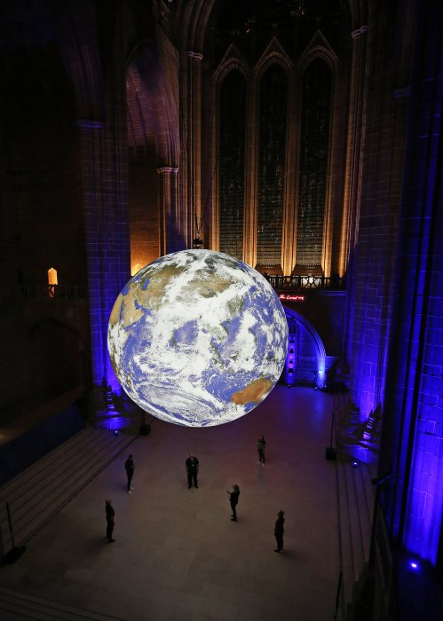 Gaia, an illuminated sculpture of Earth, hangs in the centre of Liverpool Cathedral