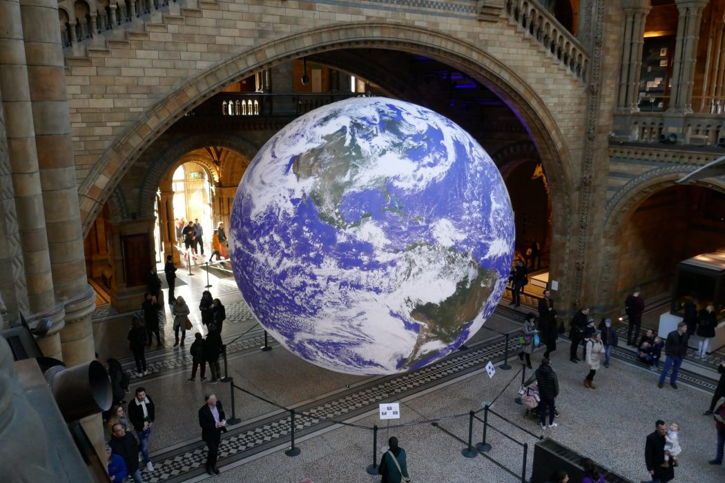Gaia, an illuminated sculpture of Earth, hangs in the Natural History Museum in London