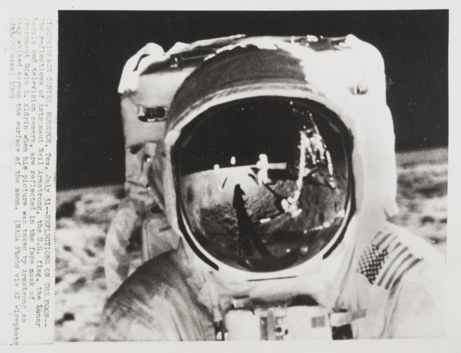 The reflections of Astronaut Neil Armstrong, the US flag, the Lunar Module and television camera, are reflected in the face mask of Astronaut Edwin E Aldrin when the picture was taken by Armstrong as they walked across the surface of the moon