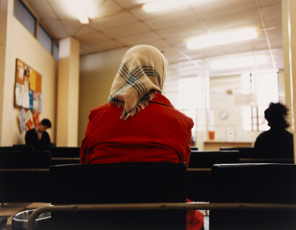 Woman in Headscarf, DHSS Waiting Room, Bristol from the series Beyond Caring, 1984, by Paul Graham