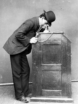 Publicity photograph of man using Edison Kinetophone, c.1895